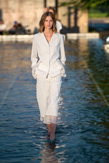NEUSS, GERMANY - JULY 20: A model walks the runway on the water at the Annette Goertz Fashion Show Spring-Summer 2020 at Langen Foundation on July 20, 2019 in Neuss, Germany. (Photo by Thomas Lohnes/Getty Images for Annette Goertz)